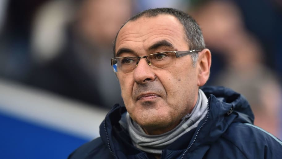 Chelsea's Italian head coach Maurizio Sarri arrives for the English Premier League football match between Brighton and Hove Albion and Chelsea at the American Express Community Stadium in Brighton, southern England on December 16, 2018. (Photo by Glyn KIRK / AFP) / RESTRICTED TO EDITORIAL USE. No use with unauthorized audio, video, data, fixture lists, club/league logos or 'live' services. Online in-match use limited to 120 images. An additional 40 images may be used in extra time. No video emulation. Social media in-match use limited to 120 images. An additional 40 images may be used in extra time. No use in betting publications, games or single club/league/player publications. /         (Photo credit should read GLYN KIRK/AFP/Getty Images)