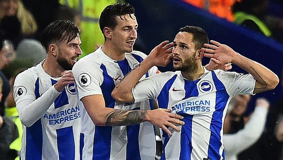 Brighton's Romanian striker Florin Andone (R) celebrates scoring his team's third goal during the English Premier League football match between Brighton and Hove Albion and Crystal Palace at the American Express Community Stadium in Brighton, southern England on December 4, 2018. (Photo by Glyn KIRK / AFP) / RESTRICTED TO EDITORIAL USE. No use with unauthorized audio, video, data, fixture lists, club/league logos or 'live' services. Online in-match use limited to 120 images. An additional 40 images may be used in extra time. No video emulation. Social media in-match use limited to 120 images. An additional 40 images may be used in extra time. No use in betting publications, games or single club/league/player publications. /         (Photo credit should read GLYN KIRK/AFP/Getty Images)