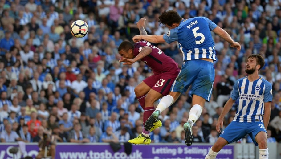 Brighton's English defender Lewis Dunk (2nd R) heads the ball into his own net under pressure from Manchester City's Brazilian striker Gabriel Jesus (L) during the English Premier League football match between Brighton and Hove Albion and Manchester City at the American Express Community Stadium in Brighton, southern England on August 12, 2017. / AFP PHOTO / CHRIS J RATCLIFFE / RESTRICTED TO EDITORIAL USE. No use with unauthorized audio, video, data, fixture lists, club/league logos or 'live' services. Online in-match use limited to 75 images, no video emulation. No use in betting, games or single club/league/player publications.  /         (Photo credit should read CHRIS J RATCLIFFE/AFP/Getty Images)