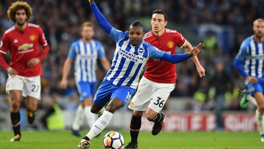 Brighton's Spanish midfielder Jose Izquierdo runs away from Manchester United's Italian defender Matteo Darmian during the English Premier League football match between Brighton and Hove Albion and Manchester United at the American Express Community Stadium in Brighton, southern England on May 4, 2018. (Photo by Glyn KIRK / AFP) / RESTRICTED TO EDITORIAL USE. No use with unauthorized audio, video, data, fixture lists, club/league logos or 'live' services. Online in-match use limited to 75 images, no video emulation. No use in betting, games or single club/league/player publications. /         (Photo credit should read GLYN KIRK/AFP/Getty Images)