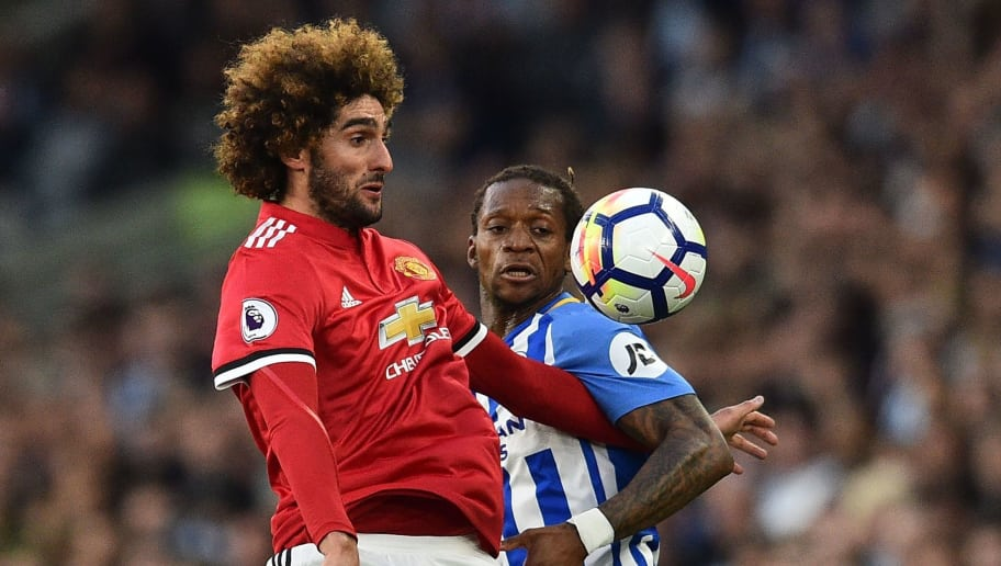 Manchester United's Belgian midfielder Marouane Fellaini (L) vies with Brighton's Cameroonian defender Gaetan Bong during the English Premier League football match between Brighton and Hove Albion and Manchester United at the American Express Community Stadium in Brighton, southern England on May 4, 2018. (Photo by Glyn KIRK / AFP) / RESTRICTED TO EDITORIAL USE. No use with unauthorized audio, video, data, fixture lists, club/league logos or 'live' services. Online in-match use limited to 75 images, no video emulation. No use in betting, games or single club/league/player publications. /         (Photo credit should read GLYN KIRK/AFP/Getty Images)