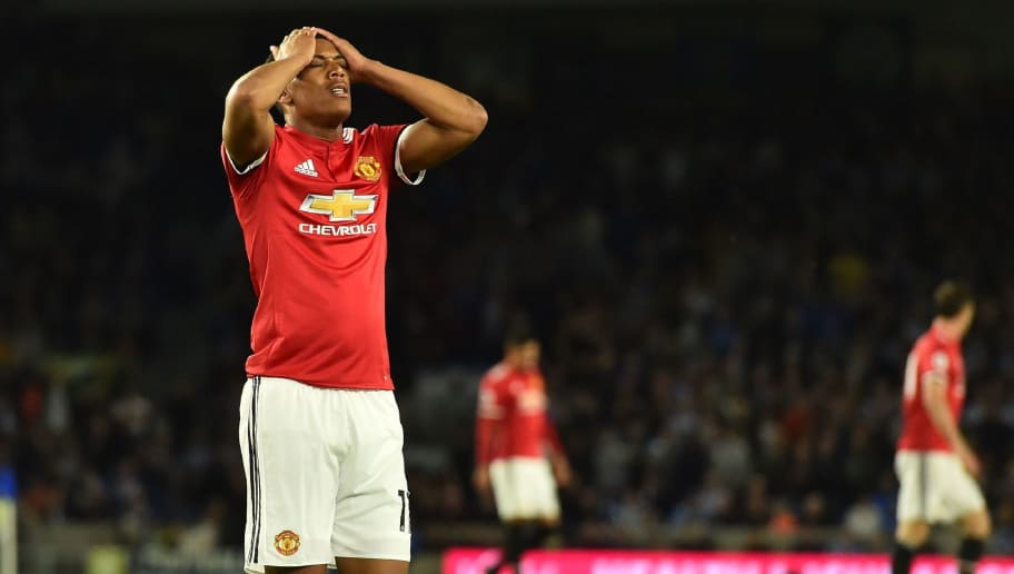 Manchester United's French striker Anthony Martial reacts after missing a chance during the English Premier League football match between Brighton and Hove Albion and Manchester United at the American Express Community Stadium in Brighton, southern England on May 4, 2018. (Photo by Glyn KIRK / AFP) / RESTRICTED TO EDITORIAL USE. No use with unauthorized audio, video, data, fixture lists, club/league logos or 'live' services. Online in-match use limited to 75 images, no video emulation. No use in betting, games or single club/league/player publications. /         (Photo credit should read GLYN KIRK/AFP/Getty Images)