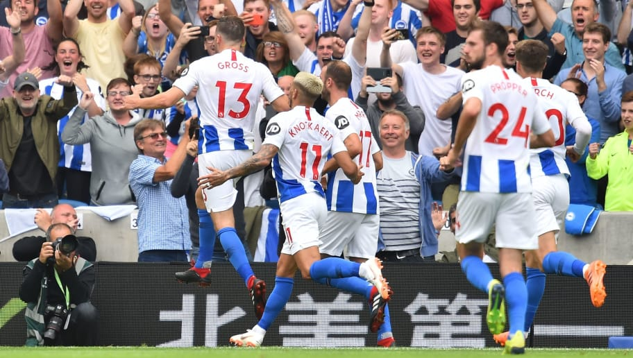 Brighton's German midfielder Pascal Gross (L) celebrates scoring their third goal from the penalty spot during the English Premier League football match between Brighton and Hove Albion and Manchester United at the American Express Community Stadium in Brighton, southern England on August 19, 2018. (Photo by Glyn KIRK / AFP) / RESTRICTED TO EDITORIAL USE. No use with unauthorized audio, video, data, fixture lists, club/league logos or 'live' services. Online in-match use limited to 120 images. An additional 40 images may be used in extra time. No video emulation. Social media in-match use limited to 120 images. An additional 40 images may be used in extra time. No use in betting publications, games or single club/league/player publications. /         (Photo credit should read GLYN KIRK/AFP/Getty Images)