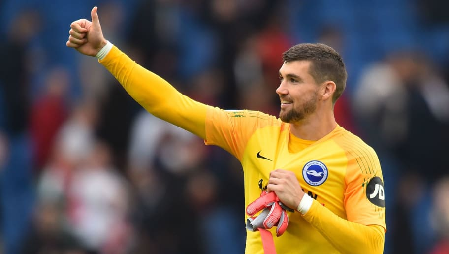 Brighton's Australian goalkeeper Mathew Ryan celebrates at the end of the English Premier League football match between Brighton and Hove Albion and Manchester United at the American Express Community Stadium in Brighton, southern England on August 19, 2018. (Photo by Glyn KIRK / AFP) / RESTRICTED TO EDITORIAL USE. No use with unauthorized audio, video, data, fixture lists, club/league logos or 'live' services. Online in-match use limited to 120 images. An additional 40 images may be used in extra time. No video emulation. Social media in-match use limited to 120 images. An additional 40 images may be used in extra time. No use in betting publications, games or single club/league/player publications. /         (Photo credit should read GLYN KIRK/AFP/Getty Images)
