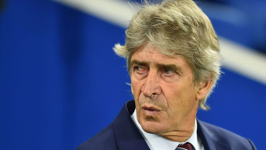 West Ham United's Chilean manager Manuel Pellegrini looks on before the English Premier League football match between Brighton and Hove Albion and West Ham at the American Express Community Stadium in Brighton, southern England on October 5, 2018. (Photo by Glyn KIRK / AFP) / RESTRICTED TO EDITORIAL USE. No use with unauthorized audio, video, data, fixture lists, club/league logos or 'live' services. Online in-match use limited to 120 images. An additional 40 images may be used in extra time. No video emulation. Social media in-match use limited to 120 images. An additional 40 images may be used in extra time. No use in betting publications, games or single club/league/player publications. /         (Photo credit should read GLYN KIRK/AFP/Getty Images)