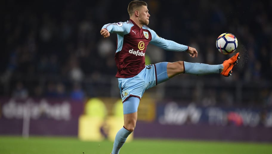 Burnley's Icelandic midfielder Johann Berg Gudmundsson controls the ball during the English Premier League football match between Burnley and Chelsea at Turf Moor in Burnley, north west England on April 19, 2018. (Photo by Oli SCARFF / AFP) / RESTRICTED TO EDITORIAL USE. No use with unauthorized audio, video, data, fixture lists, club/league logos or 'live' services. Online in-match use limited to 75 images, no video emulation. No use in betting, games or single club/league/player publications. /         (Photo credit should read OLI SCARFF/AFP/Getty Images)