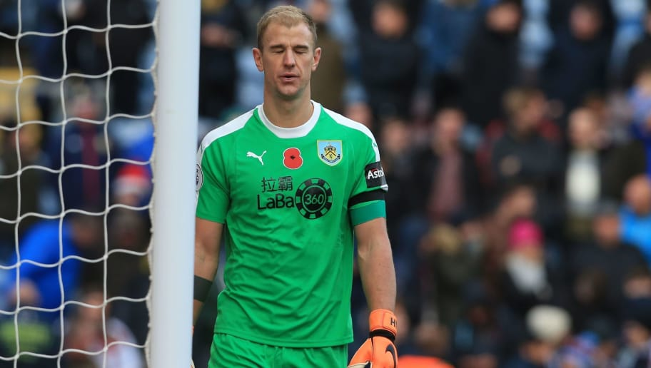 Burnley's English goalkeeper Joe Hart reacts after conceding their fourth goal during the English Premier League football match between Burnley and Chelsea at Turf Moor in Burnley, north west England on October 28, 2018. - Chelsea won the game 4-0. (Photo by Lindsey PARNABY / AFP) / RESTRICTED TO EDITORIAL USE. No use with unauthorized audio, video, data, fixture lists, club/league logos or 'live' services. Online in-match use limited to 120 images. An additional 40 images may be used in extra time. No video emulation. Social media in-match use limited to 120 images. An additional 40 images may be used in extra time. No use in betting publications, games or single club/league/player publications. /         (Photo credit should read LINDSEY PARNABY/AFP/Getty Images)