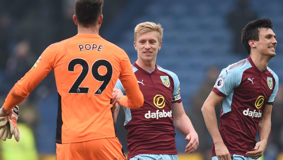 Burnley's English defender Ben Mee (C) shakes hands with Burnley's English goalkeeper Nick Pope after the English Premier League football match between Burnley and Everton at Turf Moor in Burnley, north west England on March 3, 2018. Burnley won the game 2-1. / AFP PHOTO / Oli SCARFF / RESTRICTED TO EDITORIAL USE. No use with unauthorized audio, video, data, fixture lists, club/league logos or 'live' services. Online in-match use limited to 75 images, no video emulation. No use in betting, games or single club/league/player publications.  /         (Photo credit should read OLI SCARFF/AFP/Getty Images)
