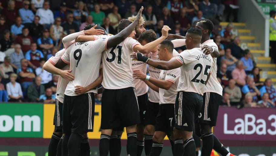 Manchester United's Belgian striker Romelu Lukaku celebrates with teammates after scoring his team's second goal during the English Premier League football match between Burnley and Manchester United at Turf Moor in Burnley, north west England on September 2, 2018. (Photo by Lindsey PARNABY / AFP) / RESTRICTED TO EDITORIAL USE. No use with unauthorized audio, video, data, fixture lists, club/league logos or 'live' services. Online in-match use limited to 120 images. An additional 40 images may be used in extra time. No video emulation. Social media in-match use limited to 120 images. An additional 40 images may be used in extra time. No use in betting publications, games or single club/league/player publications. /         (Photo credit should read LINDSEY PARNABY/AFP/Getty Images)