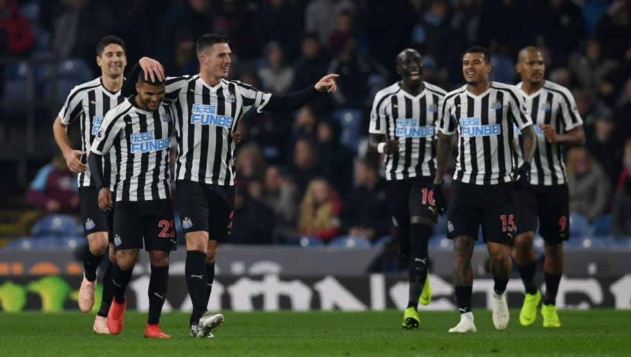 Newcastle United's Irish defender Ciaran Clark (3L) celebrates scoring his team's second goal with Newcastle United's US defender DeAndre Yedlin during the English Premier League football match between Burnley and Newcastle United at Turf Moor in Burnley, north west England on November 26, 2018. (Photo by Paul ELLIS / AFP) / RESTRICTED TO EDITORIAL USE. No use with unauthorized audio, video, data, fixture lists, club/league logos or 'live' services. Online in-match use limited to 120 images. An additional 40 images may be used in extra time. No video emulation. Social media in-match use limited to 120 images. An additional 40 images may be used in extra time. No use in betting publications, games or single club/league/player publications. /         (Photo credit should read PAUL ELLIS/AFP/Getty Images)