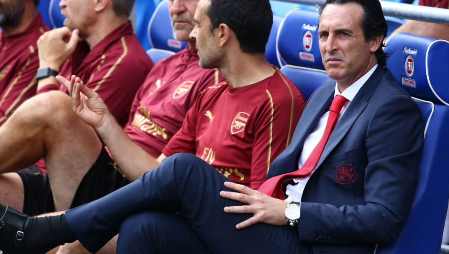 Arsenal's Spanish head coach Unai Emery (R) awaits kick off in the English Premier League football match between between Cardiff City and Arsenal at Cardiff City Stadium in Cardiff, south Wales on September 2, 2018. (Photo by Geoff CADDICK / AFP) / RESTRICTED TO EDITORIAL USE. No use with unauthorized audio, video, data, fixture lists, club/league logos or 'live' services. Online in-match use limited to 120 images. An additional 40 images may be used in extra time. No video emulation. Social media in-match use limited to 120 images. An additional 40 images may be used in extra time. No use in betting publications, games or single club/league/player publications. /         (Photo credit should read GEOFF CADDICK/AFP/Getty Images)