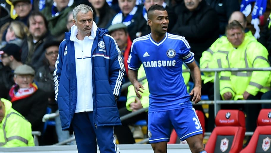 Chelsea's Portuguese manager Jose Mourinho (L) looks towards Chelsea's English defender Ashley Cole (R) during the English Premier League football match between Cardiff City and Chelsea at the Cardiff City Stadium in Cardiff on May 11, 2014.  AFP PHOTO/BEN STANSALL - RESTRICTED TO EDITORIAL USE. No use with unauthorized audio, video, data, fixture lists, club/league logos or live services. Online in-match use limited to 45 images, no video emulation. No use in betting, games or single club/league/player publications.        (Photo credit should read BEN STANSALL/AFP/Getty Images)