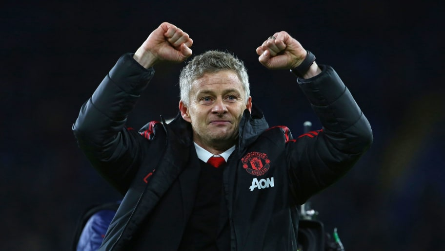 Manchester United's Norwegian caretaker manager Ole Gunnar Solskjaer celebrates on the pitch after the English Premier League football match between between Cardiff City and Manchester United at Cardiff City Stadium in Cardiff, south Wales on  December 22, 2018. - Manchester United won the game 5-1. (Photo by Geoff CADDICK / AFP) / RESTRICTED TO EDITORIAL USE. No use with unauthorized audio, video, data, fixture lists, club/league logos or 'live' services. Online in-match use limited to 120 images. An additional 40 images may be used in extra time. No video emulation. Social media in-match use limited to 120 images. An additional 40 images may be used in extra time. No use in betting publications, games or single club/league/player publications. /         (Photo credit should read GEOFF CADDICK/AFP/Getty Images)