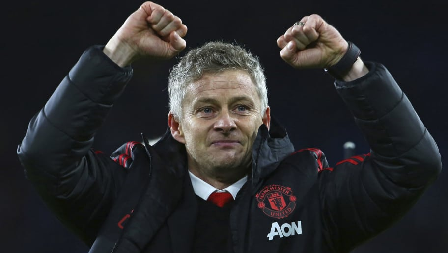 Manchester United's Norwegian caretaker manager Ole Gunnar Solskjaer celebrates on the pitch after the English Premier League football match between between Cardiff City and Manchester United at Cardiff City Stadium in Cardiff, south Wales on  December 22, 2018. - Manchester United won the game 5-1. (Photo by Geoff CADDICK / AFP) / RESTRICTED TO EDITORIAL USE. No use with unauthorized audio, video, data, fixture lists, club/league logos or 'live' services. Online in-match use limited to 120 images. An additional 40 images may be used in extra time. No video emulation. Social media in-match use limited to 120 images. An additional 40 images may be used in extra time. No use in betting publications, games or single club/league/player publications. / ALTERNATIVE CROP        (Photo credit should read GEOFF CADDICK/AFP/Getty Images)