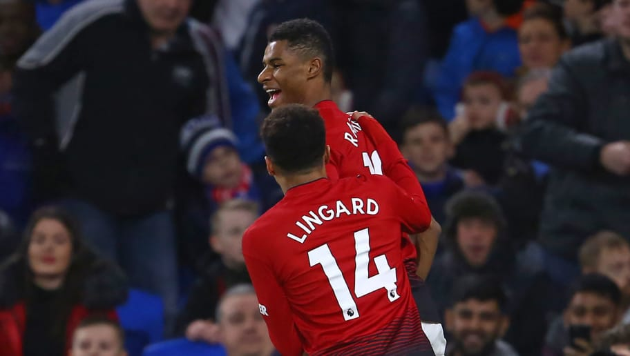 Manchester United's English striker Marcus Rashford celebrates with Manchester United's English midfielder Jesse Lingard after scoring the opening goal of the English Premier League football match between between Cardiff City and Manchester United at Cardiff City Stadium in Cardiff, south Wales on  December 22, 2018. (Photo by Geoff CADDICK / AFP) / RESTRICTED TO EDITORIAL USE. No use with unauthorized audio, video, data, fixture lists, club/league logos or 'live' services. Online in-match use limited to 120 images. An additional 40 images may be used in extra time. No video emulation. Social media in-match use limited to 120 images. An additional 40 images may be used in extra time. No use in betting publications, games or single club/league/player publications. /         (Photo credit should read GEOFF CADDICK/AFP/Getty Images)