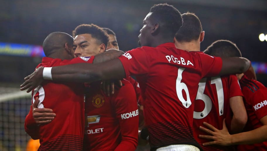 Manchester United's English midfielder Jesse Lingard (2nd L) celebrates with teammates after scoring their fourth goal from the penalty spot during the English Premier League football match between between Cardiff City and Manchester United at Cardiff City Stadium in Cardiff, south Wales on  December 22, 2018. (Photo by Geoff CADDICK / AFP) / RESTRICTED TO EDITORIAL USE. No use with unauthorized audio, video, data, fixture lists, club/league logos or 'live' services. Online in-match use limited to 120 images. An additional 40 images may be used in extra time. No video emulation. Social media in-match use limited to 120 images. An additional 40 images may be used in extra time. No use in betting publications, games or single club/league/player publications. /         (Photo credit should read GEOFF CADDICK/AFP/Getty Images)