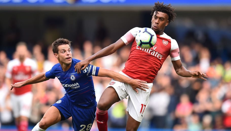 Arsenal's Nigerian striker Alex Iwobi (R) vies with Chelsea's Spanish defender Cesar Azpilicueta during the English Premier League football match between Chelsea and Arsenal at Stamford Bridge in London on August 18, 2018. (Photo by Glyn KIRK / AFP) / RESTRICTED TO EDITORIAL USE. No use with unauthorized audio, video, data, fixture lists, club/league logos or 'live' services. Online in-match use limited to 120 images. An additional 40 images may be used in extra time. No video emulation. Social media in-match use limited to 120 images. An additional 40 images may be used in extra time. No use in betting publications, games or single club/league/player publications. /         (Photo credit should read GLYN KIRK/AFP/Getty Images)
