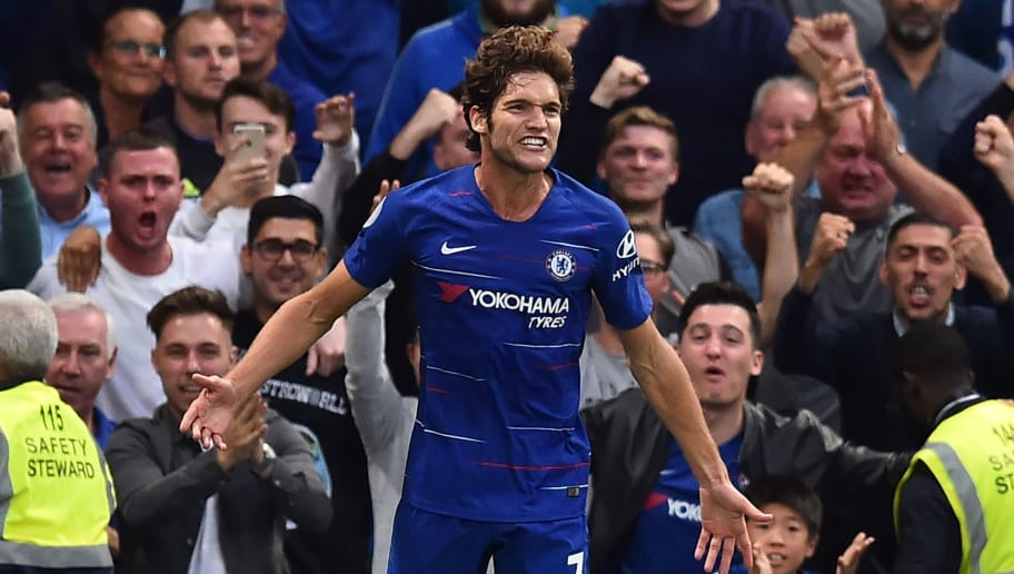 Chelsea's Spanish defender Marcos Alonso celebrates after scoring their third goal during the English Premier League football match between Chelsea and Arsenal at Stamford Bridge in London on August 18, 2018. (Photo by Glyn KIRK / AFP) / RESTRICTED TO EDITORIAL USE. No use with unauthorized audio, video, data, fixture lists, club/league logos or 'live' services. Online in-match use limited to 120 images. An additional 40 images may be used in extra time. No video emulation. Social media in-match use limited to 120 images. An additional 40 images may be used in extra time. No use in betting publications, games or single club/league/player publications. /         (Photo credit should read GLYN KIRK/AFP/Getty Images)