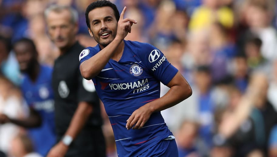 Chelsea's Spanish midfielder Pedro celebrates after scoring the opening goal of the English Premier League football match between Chelsea and Arsenal at Stamford Bridge in London on August 18, 2018. (Photo by Daniel LEAL-OLIVAS / AFP) / RESTRICTED TO EDITORIAL USE. No use with unauthorized audio, video, data, fixture lists, club/league logos or 'live' services. Online in-match use limited to 120 images. An additional 40 images may be used in extra time. No video emulation. Social media in-match use limited to 120 images. An additional 40 images may be used in extra time. No use in betting publications, games or single club/league/player publications. /         (Photo credit should read DANIEL LEAL-OLIVAS/AFP/Getty Images)