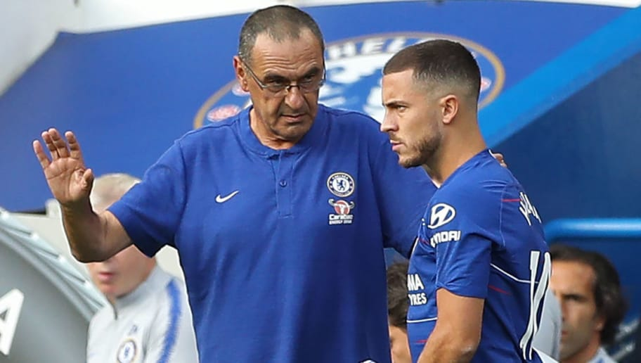 Chelsea's Italian head coach Maurizio Sarri (L) prepares to bring on Chelsea's Belgian midfielder Eden Hazard (C) and Chelsea's Croatian midfielder Mateo Kovacic (R) during the English Premier League football match between Chelsea and Arsenal at Stamford Bridge in London on August 18, 2018. (Photo by Daniel LEAL-OLIVAS / AFP) / RESTRICTED TO EDITORIAL USE. No use with unauthorized audio, video, data, fixture lists, club/league logos or 'live' services. Online in-match use limited to 120 images. An additional 40 images may be used in extra time. No video emulation. Social media in-match use limited to 120 images. An additional 40 images may be used in extra time. No use in betting publications, games or single club/league/player publications. /         (Photo credit should read DANIEL LEAL-OLIVAS/AFP/Getty Images)