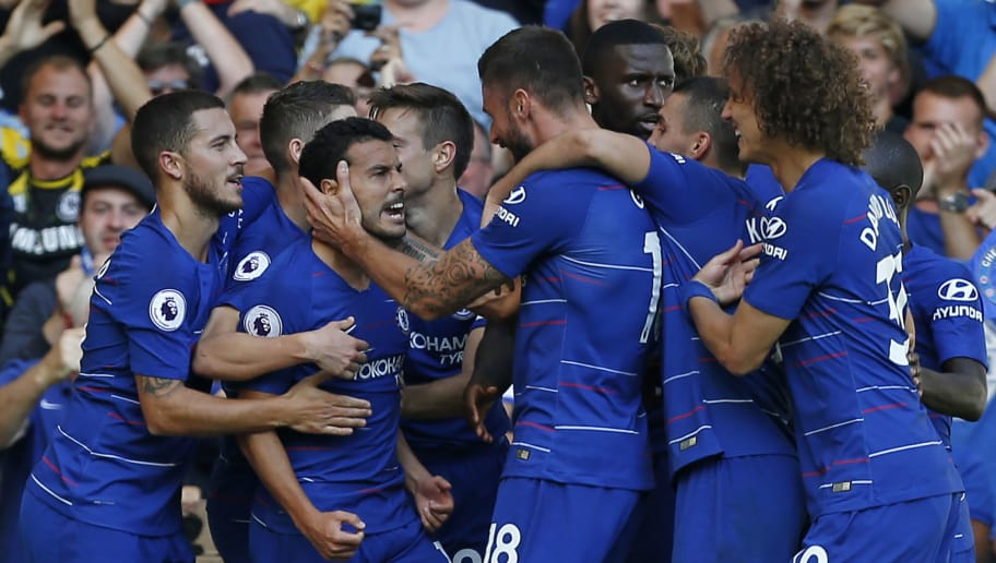 Chelsea's Spanish midfielder Pedro (3rd L) celebrates with teammates after scoring the opening goal of the English Premier League football match between Chelsea and Bournemouth at Stamford Bridge in London on September 1, 2018. (Photo by Ian KINGTON / AFP) / RESTRICTED TO EDITORIAL USE. No use with unauthorized audio, video, data, fixture lists, club/league logos or 'live' services. Online in-match use limited to 120 images. An additional 40 images may be used in extra time. No video emulation. Social media in-match use limited to 120 images. An additional 40 images may be used in extra time. No use in betting publications, games or single club/league/player publications. /         (Photo credit should read IAN KINGTON/AFP/Getty Images)