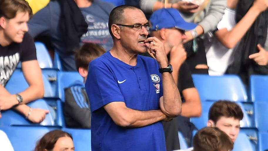 Chelsea's Italian head coach Maurizio Sarri watches during the English Premier League football match between Chelsea and Cardiff City at Stamford Bridge in London on September 15, 2018. (Photo by Glyn KIRK / AFP) / RESTRICTED TO EDITORIAL USE. No use with unauthorized audio, video, data, fixture lists, club/league logos or 'live' services. Online in-match use limited to 120 images. An additional 40 images may be used in extra time. No video emulation. Social media in-match use limited to 120 images. An additional 40 images may be used in extra time. No use in betting publications, games or single club/league/player publications. /         (Photo credit should read GLYN KIRK/AFP/Getty Images)