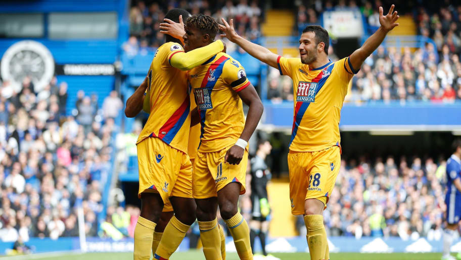 Crystal Palace's Zaire-born Belgian striker Christian Benteke (L) celebrates with teammates after scoring their second goal during the English Premier League football match between Chelsea and Crystal Palace at Stamford Bridge in London on April 1, 2017. / AFP PHOTO / Ian KINGTON / RESTRICTED TO EDITORIAL USE. No use with unauthorized audio, video, data, fixture lists, club/league logos or 'live' services. Online in-match use limited to 75 images, no video emulation. No use in betting, games or single club/league/player publications.  /         (Photo credit should read IAN KINGTON/AFP/Getty Images)