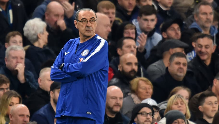 Chelsea's Italian head coach Maurizio Sarri looks on during the English Premier League football match between Chelsea and Crystal Palace at Stamford Bridge in London on November 4, 2018. (Photo by Glyn KIRK / AFP) / RESTRICTED TO EDITORIAL USE. No use with unauthorized audio, video, data, fixture lists, club/league logos or 'live' services. Online in-match use limited to 120 images. An additional 40 images may be used in extra time. No video emulation. Social media in-match use limited to 120 images. An additional 40 images may be used in extra time. No use in betting publications, games or single club/league/player publications. /         (Photo credit should read GLYN KIRK/AFP/Getty Images)