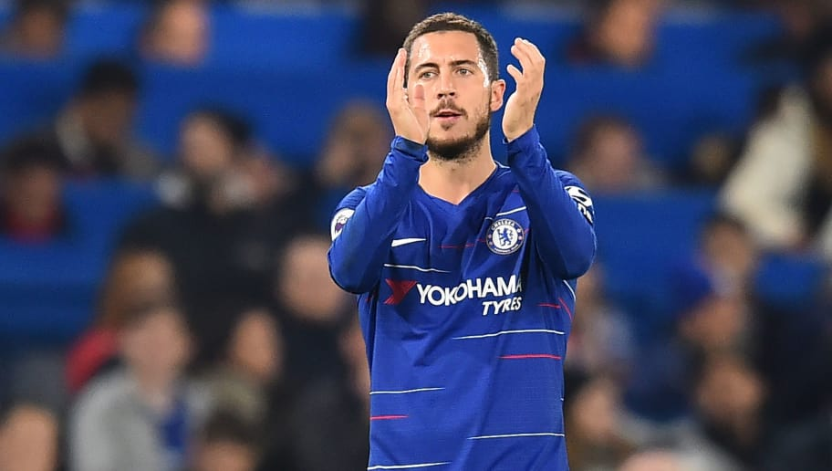 Chelsea's Belgian midfielder Eden Hazard applauds supporters on the pitch after the English Premier League football match between Chelsea and Crystal Palace at Stamford Bridge in London on November 4, 2018. - Chelsea won the game 3-1. (Photo by Glyn KIRK / AFP) / RESTRICTED TO EDITORIAL USE. No use with unauthorized audio, video, data, fixture lists, club/league logos or 'live' services. Online in-match use limited to 120 images. An additional 40 images may be used in extra time. No video emulation. Social media in-match use limited to 120 images. An additional 40 images may be used in extra time. No use in betting publications, games or single club/league/player publications. /         (Photo credit should read GLYN KIRK/AFP/Getty Images)