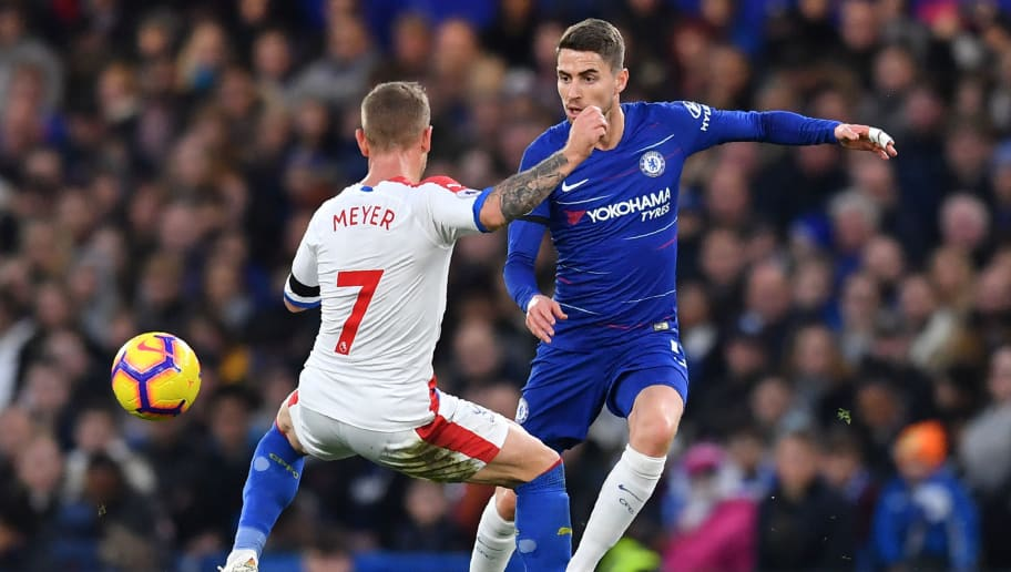 Chelsea's Italian midfielder Jorginho (R) vies with Crystal Palace's German midfielder Max Meyer (L) during the English Premier League football match between Chelsea and Crystal Palace at Stamford Bridge in London on November 4, 2018. (Photo by Ben STANSALL / AFP) / RESTRICTED TO EDITORIAL USE. No use with unauthorized audio, video, data, fixture lists, club/league logos or 'live' services. Online in-match use limited to 120 images. An additional 40 images may be used in extra time. No video emulation. Social media in-match use limited to 120 images. An additional 40 images may be used in extra time. No use in betting publications, games or single club/league/player publications. /         (Photo credit should read BEN STANSALL/AFP/Getty Images)