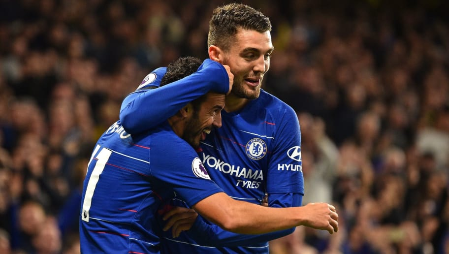 Chelsea's Spanish midfielder Pedro (L) celebrates with Chelsea's Croatian midfielder Mateo Kovacic after scoring their third goal during the English Premier League football match between Chelsea and Crystal Palace at Stamford Bridge in London on November 4, 2018. (Photo by Glyn KIRK / AFP) / RESTRICTED TO EDITORIAL USE. No use with unauthorized audio, video, data, fixture lists, club/league logos or 'live' services. Online in-match use limited to 120 images. An additional 40 images may be used in extra time. No video emulation. Social media in-match use limited to 120 images. An additional 40 images may be used in extra time. No use in betting publications, games or single club/league/player publications. /         (Photo credit should read GLYN KIRK/AFP/Getty Images)