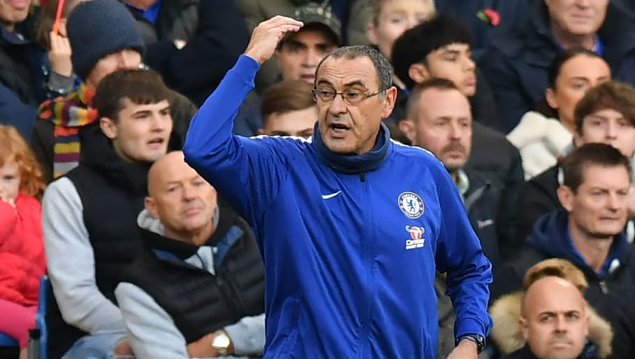 Chelsea's Italian head coach Maurizio Sarri gestures on the touchline during the English Premier League football match between Chelsea and Everton at Stamford Bridge in London on November 11, 2018. (Photo by OLLY GREENWOOD / AFP) / RESTRICTED TO EDITORIAL USE. No use with unauthorized audio, video, data, fixture lists, club/league logos or 'live' services. Online in-match use limited to 120 images. An additional 40 images may be used in extra time. No video emulation. Social media in-match use limited to 120 images. An additional 40 images may be used in extra time. No use in betting publications, games or single club/league/player publications. /         (Photo credit should read OLLY GREENWOOD/AFP/Getty Images)