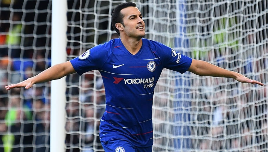 Chelsea's Spanish midfielder Pedro celebrates after scoring the opening goal of the English Premier League football match between Chelsea and Fulham at Stamford Bridge in London on December 2, 2018. (Photo by Glyn KIRK / AFP) / RESTRICTED TO EDITORIAL USE. No use with unauthorized audio, video, data, fixture lists, club/league logos or 'live' services. Online in-match use limited to 120 images. An additional 40 images may be used in extra time. No video emulation. Social media in-match use limited to 120 images. An additional 40 images may be used in extra time. No use in betting publications, games or single club/league/player publications. /         (Photo credit should read GLYN KIRK/AFP/Getty Images)