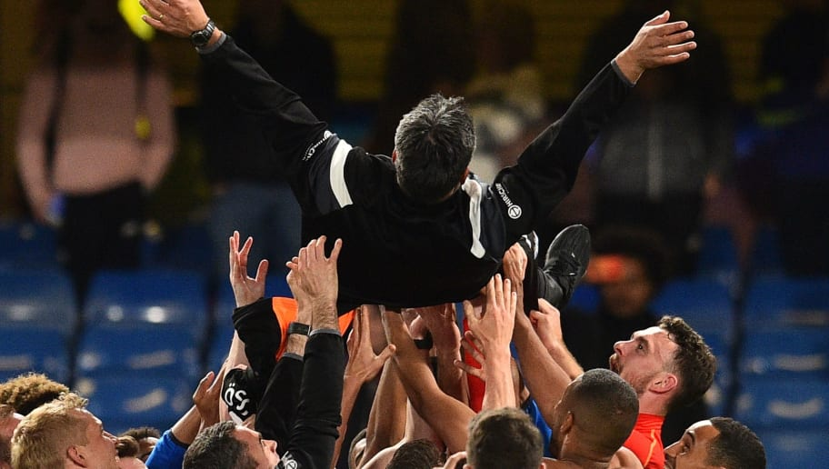 Huddersfield Town's German head coach David Wagner is thrown in the air by his players and staff as they celebrate after the final whistle during the English Premier League football match between Chelsea and Huddersfield Town at Stamford Bridge in London on May 9, 2018. - Huddersfield secured their Premier League survival with a 1-1 draw at Stamford Bridge on Wednesday. (Photo by Glyn KIRK / AFP) / RESTRICTED TO EDITORIAL USE. No use with unauthorized audio, video, data, fixture lists, club/league logos or 'live' services. Online in-match use limited to 75 images, no video emulation. No use in betting, games or single club/league/player publications. /         (Photo credit should read GLYN KIRK/AFP/Getty Images)