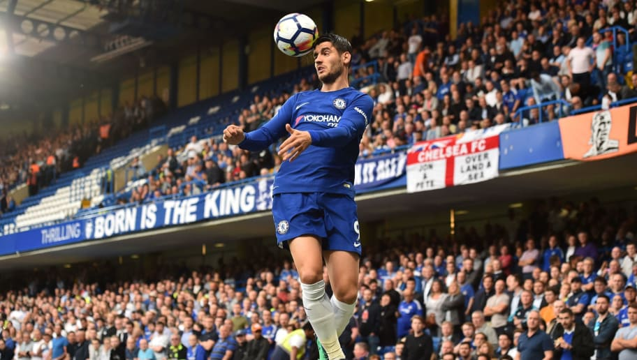 Chelsea's Spanish striker Alvaro Morata heads the ball during the English Premier League football match between Chelsea and Huddersfield Town at Stamford Bridge in London on May 9, 2018. (Photo by Glyn KIRK / AFP) / RESTRICTED TO EDITORIAL USE. No use with unauthorized audio, video, data, fixture lists, club/league logos or 'live' services. Online in-match use limited to 75 images, no video emulation. No use in betting, games or single club/league/player publications. /         (Photo credit should read GLYN KIRK/AFP/Getty Images)