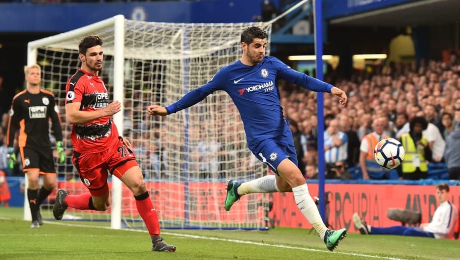 Chelsea's Spanish striker Alvaro Morata (R) chases the ball to try to keep it in play followed by Huddersfield Town's German defender Christopher Schindler (L) during the English Premier League football match between Chelsea and Huddersfield Town at Stamford Bridge in London on May 9, 2018. (Photo by Glyn KIRK / AFP) / RESTRICTED TO EDITORIAL USE. No use with unauthorized audio, video, data, fixture lists, club/league logos or 'live' services. Online in-match use limited to 75 images, no video emulation. No use in betting, games or single club/league/player publications. /         (Photo credit should read GLYN KIRK/AFP/Getty Images)