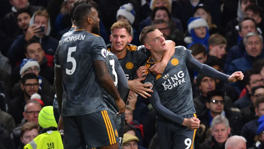 Leicester City's English striker Jamie Vardy (R) celebrates with teammates after scoring the opening goal of the English Premier League football match between Chelsea and Leicester City at Stamford Bridge in London on December 22, 2018. (Photo by Ben STANSALL / AFP) / RESTRICTED TO EDITORIAL USE. No use with unauthorized audio, video, data, fixture lists, club/league logos or 'live' services. Online in-match use limited to 120 images. An additional 40 images may be used in extra time. No video emulation. Social media in-match use limited to 120 images. An additional 40 images may be used in extra time. No use in betting publications, games or single club/league/player publications. /         (Photo credit should read BEN STANSALL/AFP/Getty Images)