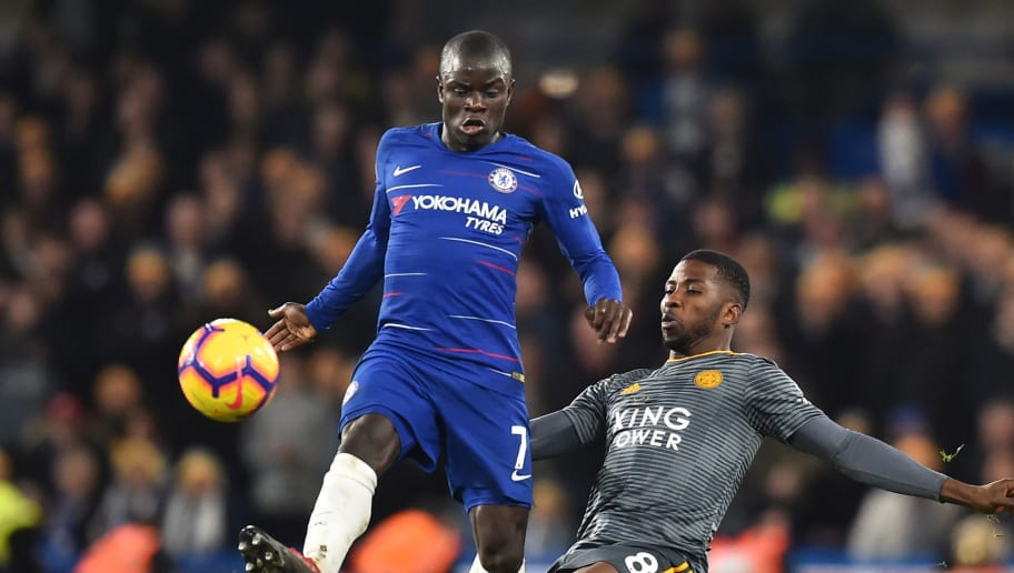 Chelsea's French midfielder N'Golo Kante (L) vies with Leicester City's Nigerian striker Kelechi Iheanacho (R) during the English Premier League football match between Chelsea and Leicester City at Stamford Bridge in London on December 22, 2018. (Photo by Glyn KIRK / AFP) / RESTRICTED TO EDITORIAL USE. No use with unauthorized audio, video, data, fixture lists, club/league logos or 'live' services. Online in-match use limited to 120 images. An additional 40 images may be used in extra time. No video emulation. Social media in-match use limited to 120 images. An additional 40 images may be used in extra time. No use in betting publications, games or single club/league/player publications. /         (Photo credit should read GLYN KIRK/AFP/Getty Images)