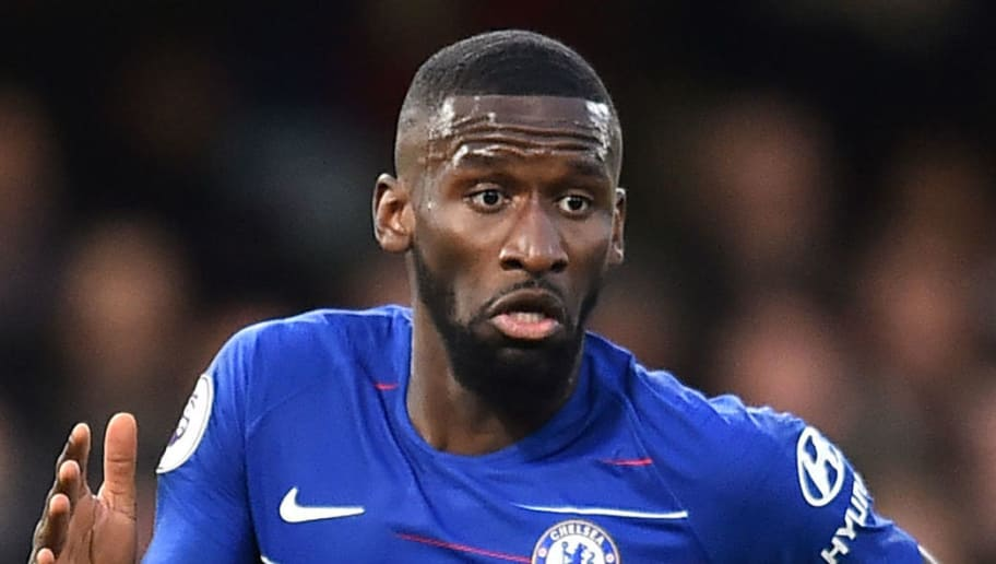 Chelsea's German defender Antonio Rudiger runs with the ball during the English Premier League football match between Chelsea and Leicester City at Stamford Bridge in London on December 22, 2018. (Photo by Glyn KIRK / AFP) / RESTRICTED TO EDITORIAL USE. No use with unauthorized audio, video, data, fixture lists, club/league logos or 'live' services. Online in-match use limited to 120 images. An additional 40 images may be used in extra time. No video emulation. Social media in-match use limited to 120 images. An additional 40 images may be used in extra time. No use in betting publications, games or single club/league/player publications. /         (Photo credit should read GLYN KIRK/AFP/Getty Images)