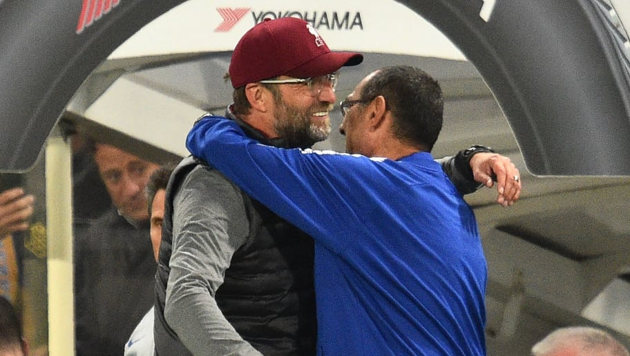 Liverpool's German manager Jurgen Klopp (L) and Chelsea's Italian head coach Maurizio Sarri interact after the English Premier League football match between Chelsea and Liverpool at Stamford Bridge in London on September 29, 2018. (Photo by Glyn KIRK / AFP) / RESTRICTED TO EDITORIAL USE. No use with unauthorized audio, video, data, fixture lists, club/league logos or 'live' services. Online in-match use limited to 120 images. An additional 40 images may be used in extra time. No video emulation. Social media in-match use limited to 120 images. An additional 40 images may be used in extra time. No use in betting publications, games or single club/league/player publications. /         (Photo credit should read GLYN KIRK/AFP/Getty Images)