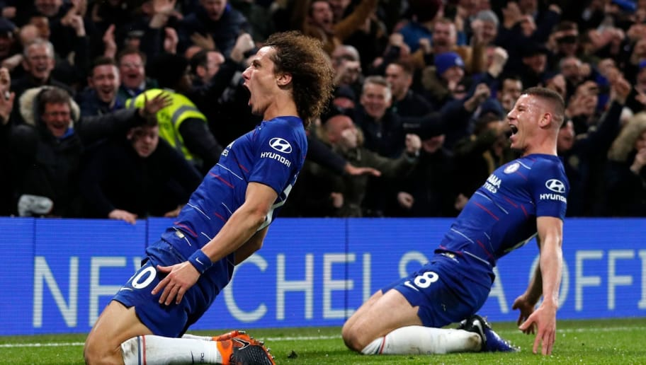 Chelsea's Brazilian defender David Luiz (L) celebrates with Chelsea's English midfielder Ross Barkley after scoring their second goal during the English Premier League football match between Chelsea and Manchester City at Stamford Bridge in London on December 8, 2018. (Photo by Adrian DENNIS / AFP) / RESTRICTED TO EDITORIAL USE. No use with unauthorized audio, video, data, fixture lists, club/league logos or 'live' services. Online in-match use limited to 120 images. An additional 40 images may be used in extra time. No video emulation. Social media in-match use limited to 120 images. An additional 40 images may be used in extra time. No use in betting publications, games or single club/league/player publications. /         (Photo credit should read ADRIAN DENNIS/AFP/Getty Images)