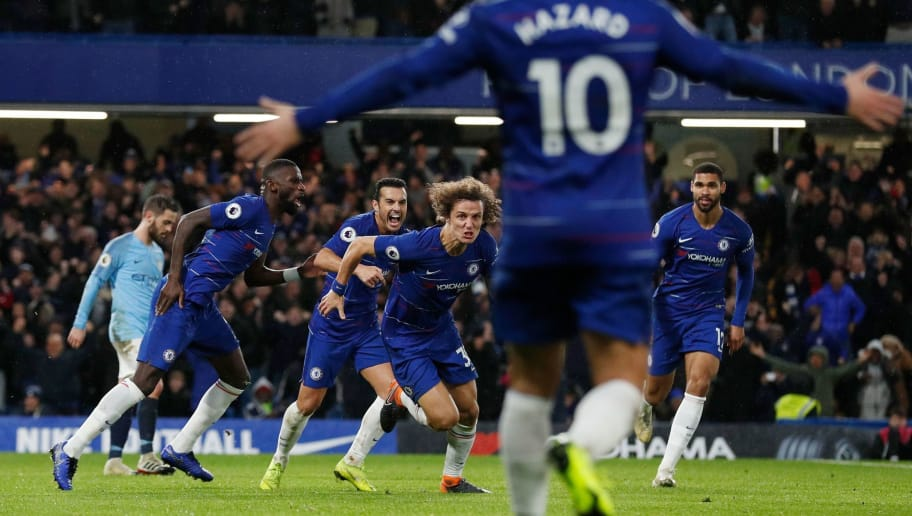 Chelsea's Brazilian defender David Luiz (C) celebrates after scoring their second goal during the English Premier League football match between Chelsea and Manchester City at Stamford Bridge in London on December 8, 2018. (Photo by Adrian DENNIS / AFP) / RESTRICTED TO EDITORIAL USE. No use with unauthorized audio, video, data, fixture lists, club/league logos or 'live' services. Online in-match use limited to 120 images. An additional 40 images may be used in extra time. No video emulation. Social media in-match use limited to 120 images. An additional 40 images may be used in extra time. No use in betting publications, games or single club/league/player publications. /         (Photo credit should read ADRIAN DENNIS/AFP/Getty Images)