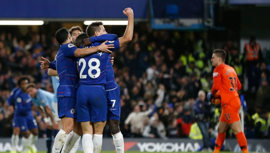 Chelsea's French midfielder N'Golo Kante celebrates with Chelsea's Spanish defender Cesar Azpilicueta (R) afer scoring during the English Premier League football match between Chelsea and Manchester City at Stamford Bridge in London on December 8, 2018. (Photo by Ian KINGTON / AFP) / RESTRICTED TO EDITORIAL USE. No use with unauthorized audio, video, data, fixture lists, club/league logos or 'live' services. Online in-match use limited to 120 images. An additional 40 images may be used in extra time. No video emulation. Social media in-match use limited to 120 images. An additional 40 images may be used in extra time. No use in betting publications, games or single club/league/player publications. /         (Photo credit should read IAN KINGTON/AFP/Getty Images)