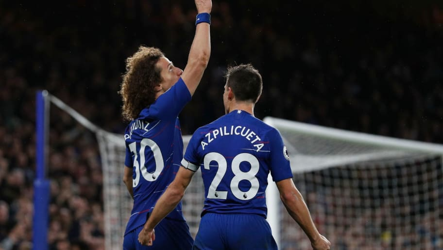 Chelsea's Brazilian defender David Luiz (L) celebrates after scoring their second goal during the English Premier League football match between Chelsea and Manchester City at Stamford Bridge in London on December 8, 2018. (Photo by Adrian DENNIS / AFP) / RESTRICTED TO EDITORIAL USE. No use with unauthorized audio, video, data, fixture lists, club/league logos or 'live' services. Online in-match use limited to 120 images. An additional 40 images may be used in extra time. No video emulation. Social media in-match use limited to 120 images. An additional 40 images may be used in extra time. No use in betting publications, games or single club/league/player publications. /         (Photo credit should read ADRIAN DENNIS/AFP/Getty Images)