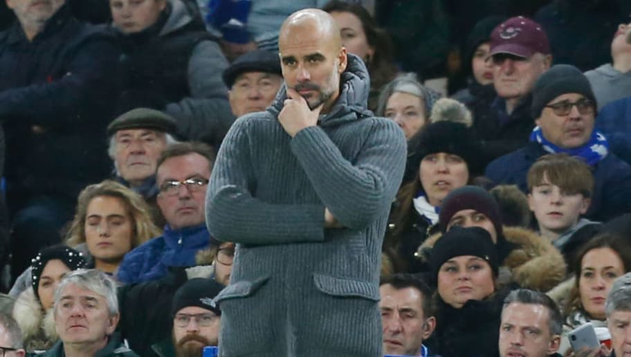 Manchester City's Spanish manager Pep Guardiola looks on during the English Premier League football match between Chelsea and Manchester City at Stamford Bridge in London on December 8, 2018. (Photo by Ian KINGTON / AFP) / RESTRICTED TO EDITORIAL USE. No use with unauthorized audio, video, data, fixture lists, club/league logos or 'live' services. Online in-match use limited to 120 images. An additional 40 images may be used in extra time. No video emulation. Social media in-match use limited to 120 images. An additional 40 images may be used in extra time. No use in betting publications, games or single club/league/player publications. /         (Photo credit should read IAN KINGTON/AFP/Getty Images)