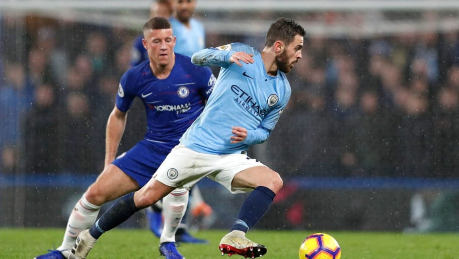 Chelsea's English midfielder Ross Barkley (L) vies with Manchester City's Portuguese midfielder Bernardo Silva during the English Premier League football match between Chelsea and Manchester City at Stamford Bridge in London on December 8, 2018. (Photo by Adrian DENNIS / AFP) / RESTRICTED TO EDITORIAL USE. No use with unauthorized audio, video, data, fixture lists, club/league logos or 'live' services. Online in-match use limited to 120 images. An additional 40 images may be used in extra time. No video emulation. Social media in-match use limited to 120 images. An additional 40 images may be used in extra time. No use in betting publications, games or single club/league/player publications. /         (Photo credit should read ADRIAN DENNIS/AFP/Getty Images)