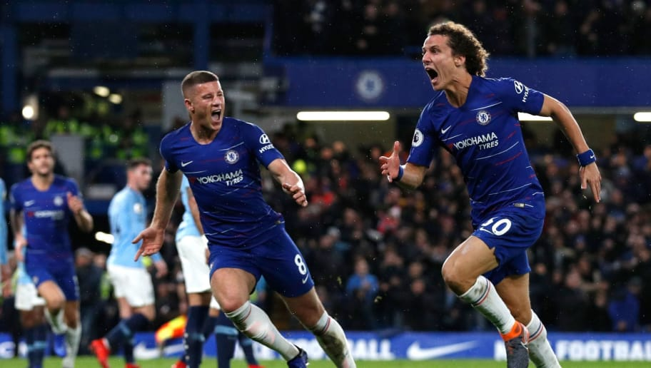 Chelsea's Brazilian defender David Luiz (R) celebrates with Chelsea's English midfielder Ross Barkley after scoring their second goal during the English Premier League football match between Chelsea and Manchester City at Stamford Bridge in London on December 8, 2018. (Photo by Adrian DENNIS / AFP) / RESTRICTED TO EDITORIAL USE. No use with unauthorized audio, video, data, fixture lists, club/league logos or 'live' services. Online in-match use limited to 120 images. An additional 40 images may be used in extra time. No video emulation. Social media in-match use limited to 120 images. An additional 40 images may be used in extra time. No use in betting publications, games or single club/league/player publications. /         (Photo credit should read ADRIAN DENNIS/AFP/Getty Images)