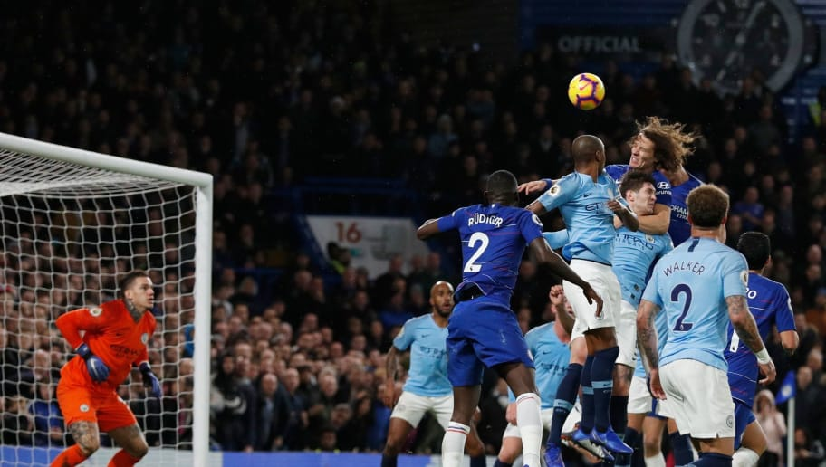 Chelsea's Brazilian defender David Luiz (top R) heads the ball to score their second goal during the English Premier League football match between Chelsea and Manchester City at Stamford Bridge in London on December 8, 2018. (Photo by Adrian DENNIS / AFP) / RESTRICTED TO EDITORIAL USE. No use with unauthorized audio, video, data, fixture lists, club/league logos or 'live' services. Online in-match use limited to 120 images. An additional 40 images may be used in extra time. No video emulation. Social media in-match use limited to 120 images. An additional 40 images may be used in extra time. No use in betting publications, games or single club/league/player publications. /         (Photo credit should read ADRIAN DENNIS/AFP/Getty Images)