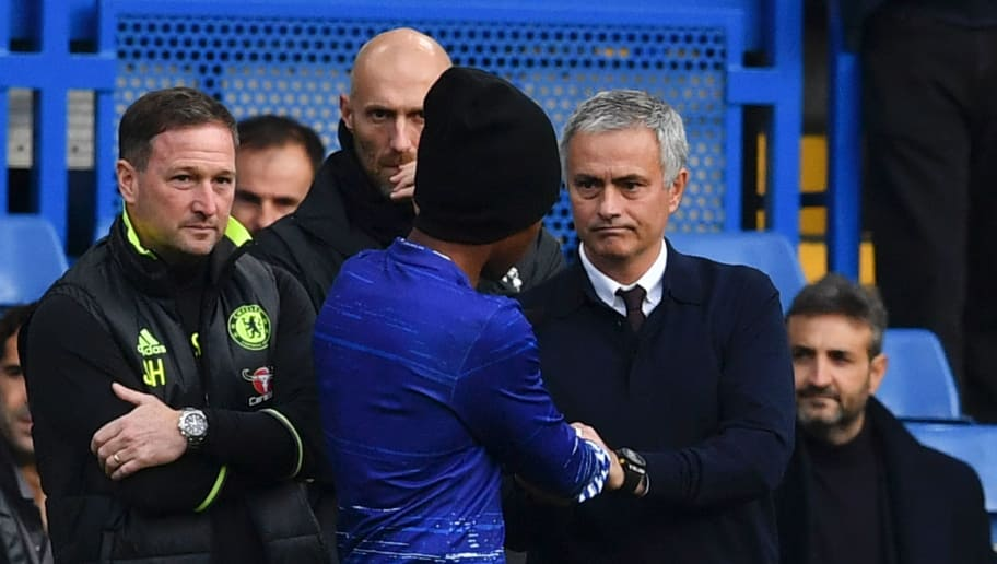 Manchester United's Portuguese manager Jose Mourinho (R) speaks to Chelsea's Brazilian midfielder Willian ahead of the English Premier League football match between Chelsea and Manchester United at Stamford Bridge in London on October 23, 2016. / AFP / Ben STANSALL / RESTRICTED TO EDITORIAL USE. No use with unauthorized audio, video, data, fixture lists, club/league logos or 'live' services. Online in-match use limited to 75 images, no video emulation. No use in betting, games or single club/league/player publications.  /         (Photo credit should read BEN STANSALL/AFP/Getty Images)