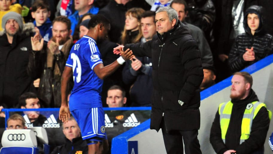 Chelsea's Portuguese manager Jose Mourinho (R) shakes hands with Chelsea's Cameroonian striker Samuel Eto'o after substituting him during the English Premier League football match between Chelsea and Manchester United at Stamford Bridge in London on January 19, 2014. Chelsea won the match 3-1.  AFP PHOTO / GLYN KIRK  RESTRICTED TO EDITORIAL USE. No use with unauthorized audio, video, data, fixture lists, club/league logos or live services. Online in-match use limited to 45 images, no video emulation. No use in betting, games or single club/league/player publications.        (Photo credit should read GLYN KIRK/AFP/Getty Images)